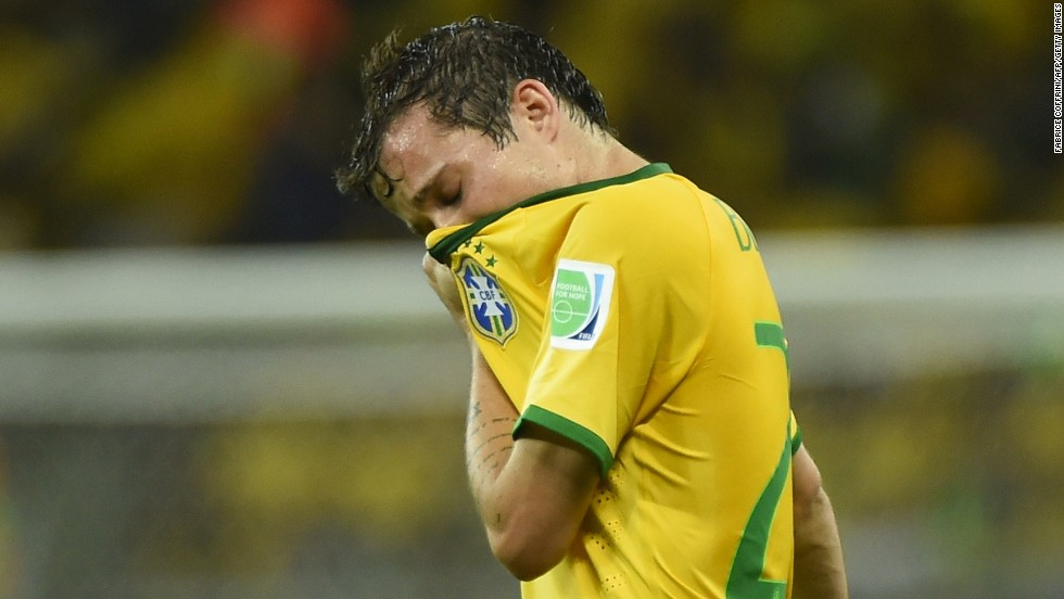 Brazil's Bernard wipes his face during the match.