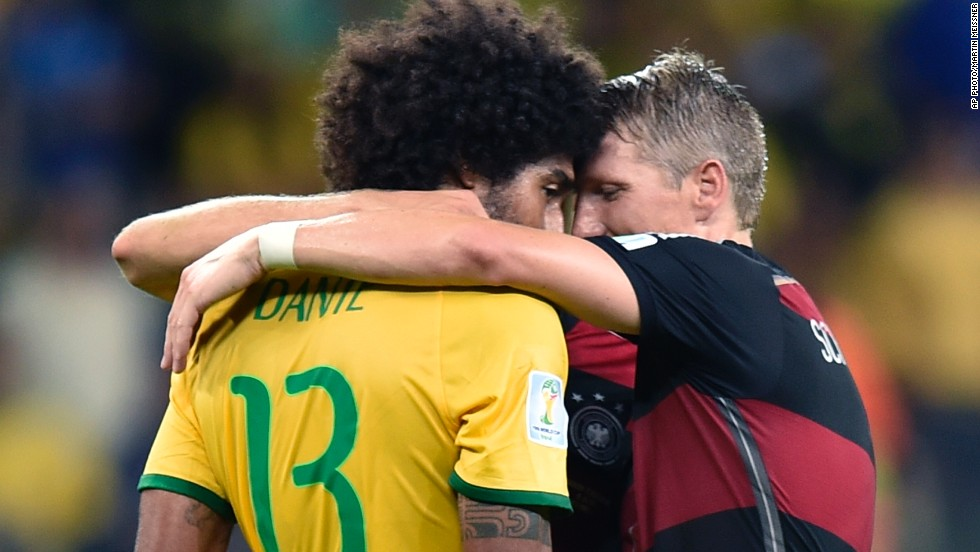 "BELO HORIZONTE - JULY 9: Germany's Bastian Schweinsteiger consoles Brazil's Dante after Germany won the World Cup semifinal soccer match 7-1, <a href=""http://edition.cnn.com/2014/07/08/sport/football/world-cup-brazil-germany-football/index.html?hpt=isp_c1"">breaking the hearts of millions of Brazilian fans</a>."