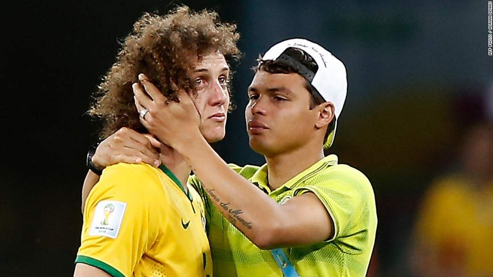 Brazil's stand-in captain David Luiz was left in tears after his side was thrashed 7-1 in the semifinal by Germany. Brazil, hoping to win the tournament for a sixth time, trailed 5-0 at halftime. Coach Luiz Felipe Scolari said it was the worst day of his life.