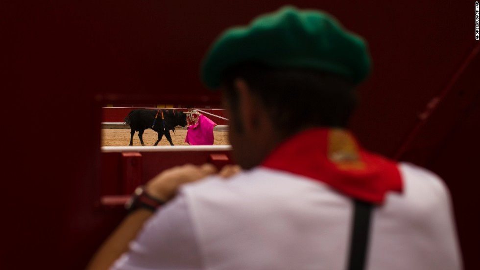 A worker watches a bullfight on July 8.
