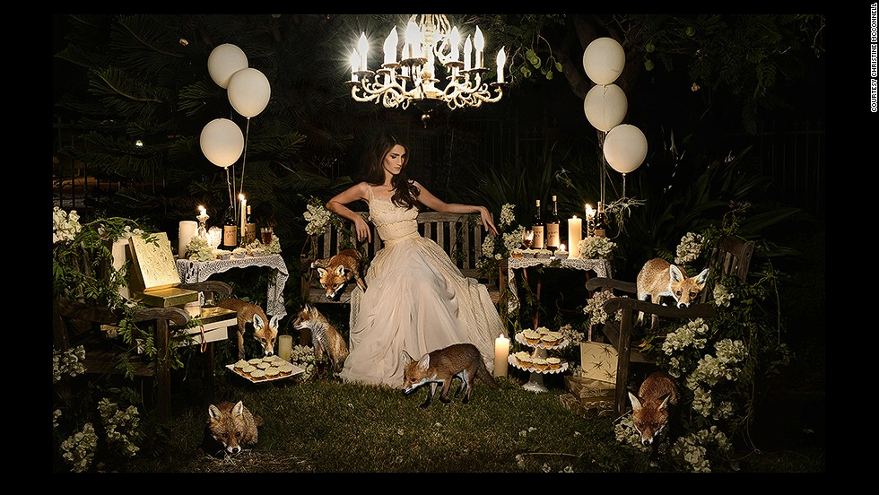 "The setting is eerily calm.<br /><br />A beautiful girl sits on a bench surrounded by remnants of a party, while wild foxes roam and feast on her baked creations. Her gaze is lowered, and there is a mysterious atmosphere, with dark shadows concealing unknown dangers. <br /><br />If you are unsettled by this scene, this is exactly what the photographer <a href=""http://instagram.com/christinehmcconnell"" target=""_blank"">Christine McConnell</a>, pictured above, was trying to achieve. In her images, the Los Angeles-based artist combines the glamor of 1950s pin-ups with Tim Burtone-esque elements of twisted fantasy. <br /><br />By <strong><a href=""https://twitter.com/M_Veselinovic"" target=""_blank"">Milena Veselinovic</strong></a>, for CNN"