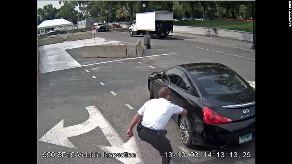 The U.S. Attorney's Office in Washington released stills from video footage of an October car chase in Washington that ended with the killing of Miriam Carey, the driver. On Thursday, federal prosecutors determined that no charges will be sought against the law enforcement officials involved.  This still was taken from video footage at the White House checkpoint, and shows a U.S. Secret Service officer trying to get Carey's attention after she entered the restricted area.