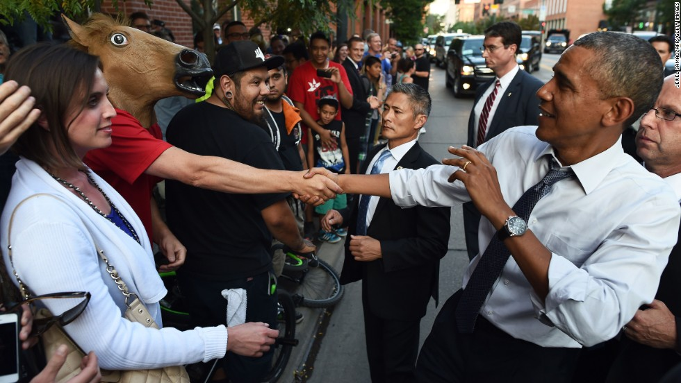 "U.S. President Barack Obama shakes hands with a man wearing a horse mask Tuesday, July 8, in downtown Denver. Obama <a href=""http://www.cnn.com/2014/07/09/politics/obama-denver-night-out/index.html"">had an interesting night</a> in the city after he headlined a Democratic fundraiser earlier in the day. One man in a bar even offered marijuana to the President. As for the man in the horse mask, ""it's unclear what message he hoped to convey,"" wrote the pool reporter assigned to cover the visit."