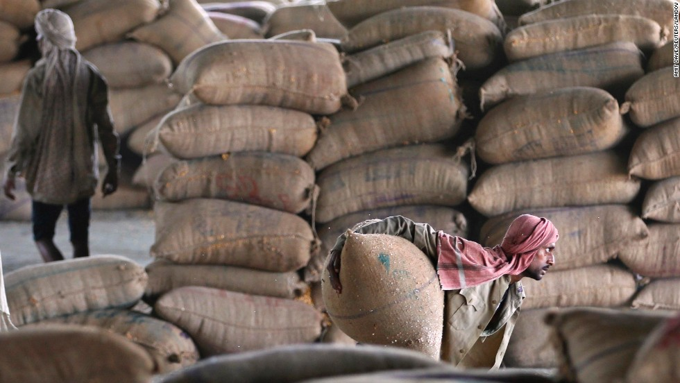 "A worker unloads a sack filled with maize from a train in Ahmedabad, India, on Tuesday, July 8. <a href=""http://www.cnn.com/2014/07/04/world/gallery/week-in-photos-0703/index.html"">See last week in 34 photos</a>"