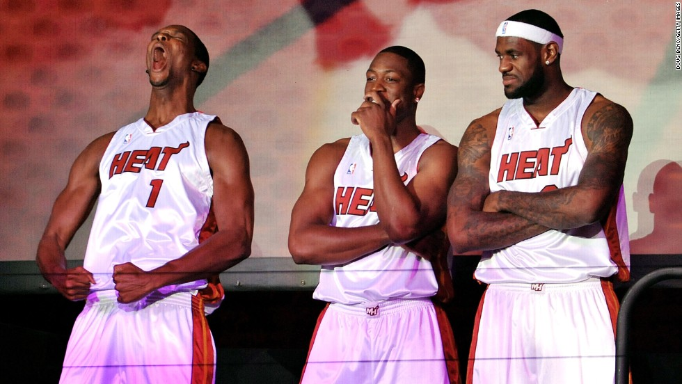 From left, Chris Bosh, Dwyane Wade and James are introduced to Miami Heat fans during a welcome party in Miami in July 2010.