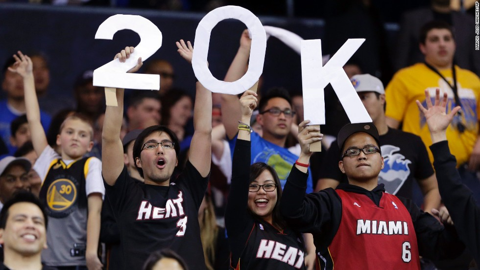 Fans hold a sign commemorating James' 20,000th career point, which he scored in January 2013 against the Golden State Warriors in Oakland, California.