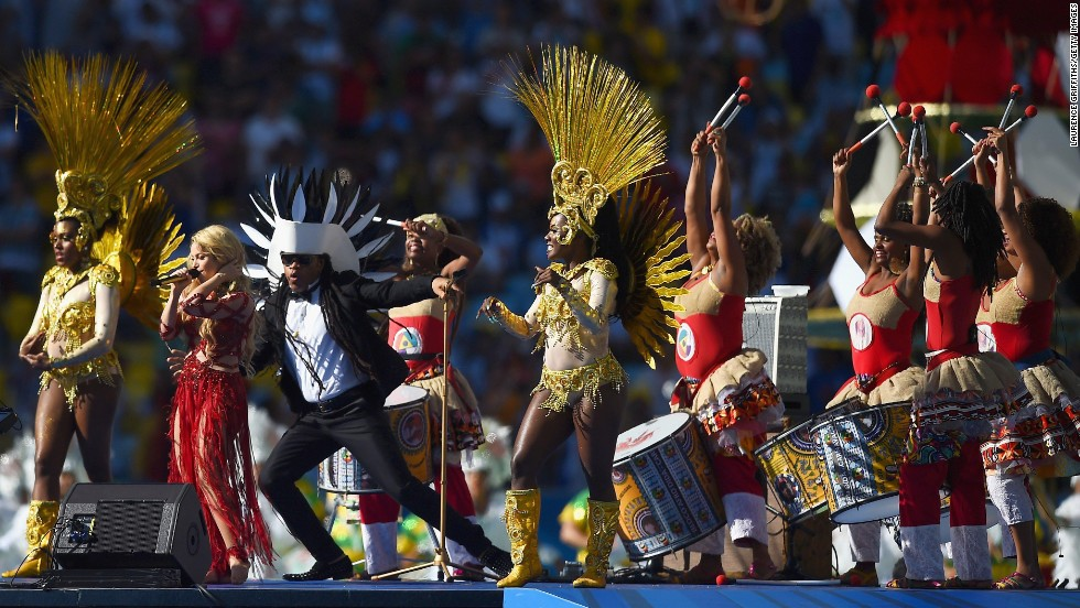 Pop star Shakira, second from left, performs in the closing ceremony prior to the match.