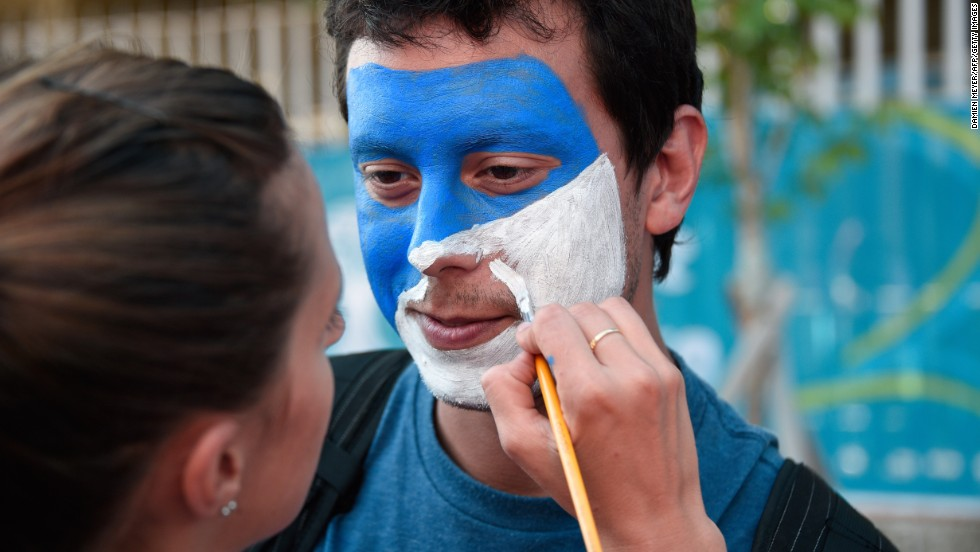 A fan has his face painted in Argentina's national colors prior to the final.