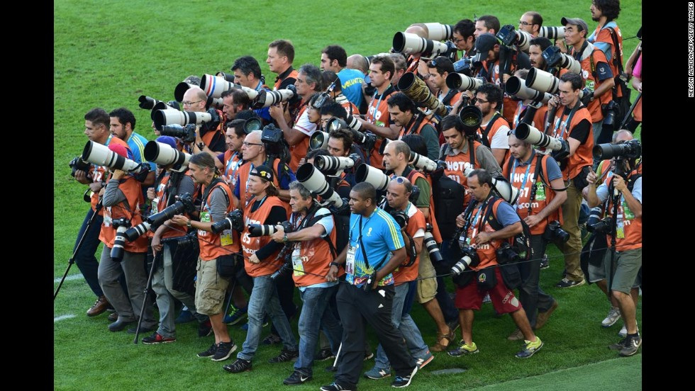 Photographers gather to take team photos before the match.