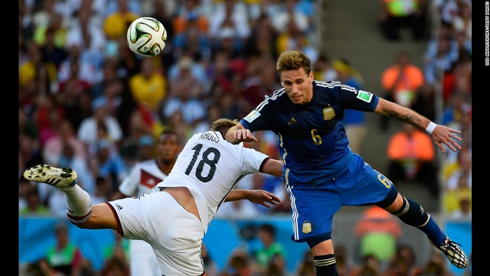 Germany's Toni Kroos, left, collides with Biglia.