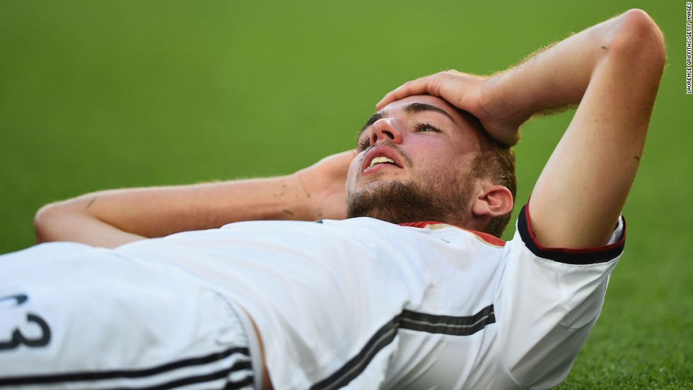 Germany's Christoph Kramer lies on the field after a collision in the first half. He later had to be substituted.