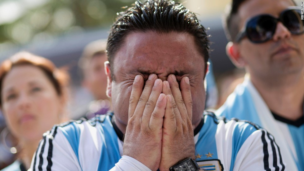 An Argentina fan in Miami Beach, Florida, reacts after his team lost the final.