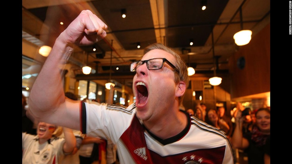 A Germany fan celebrates while watching the match in Melbourne.