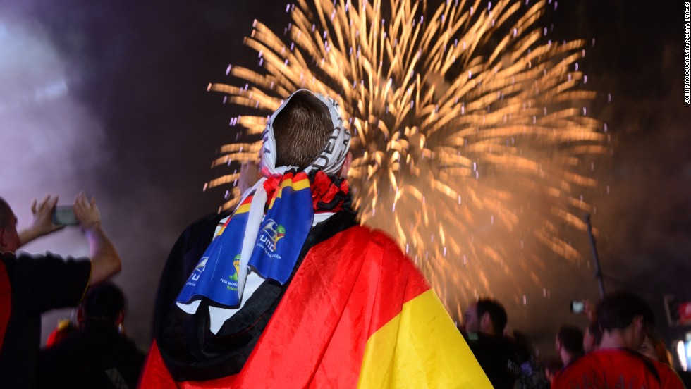 German fans watch a fireworks show near the Brandenburg Gate in Berlin.