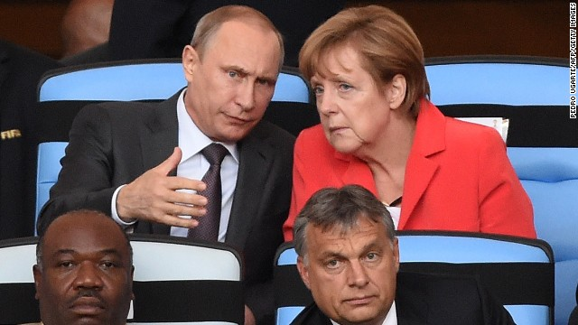 German Chancellor Angela Merkel (top R) and Russian President Vladimir Putin chat  during the 2014 FIFA World Cup final.