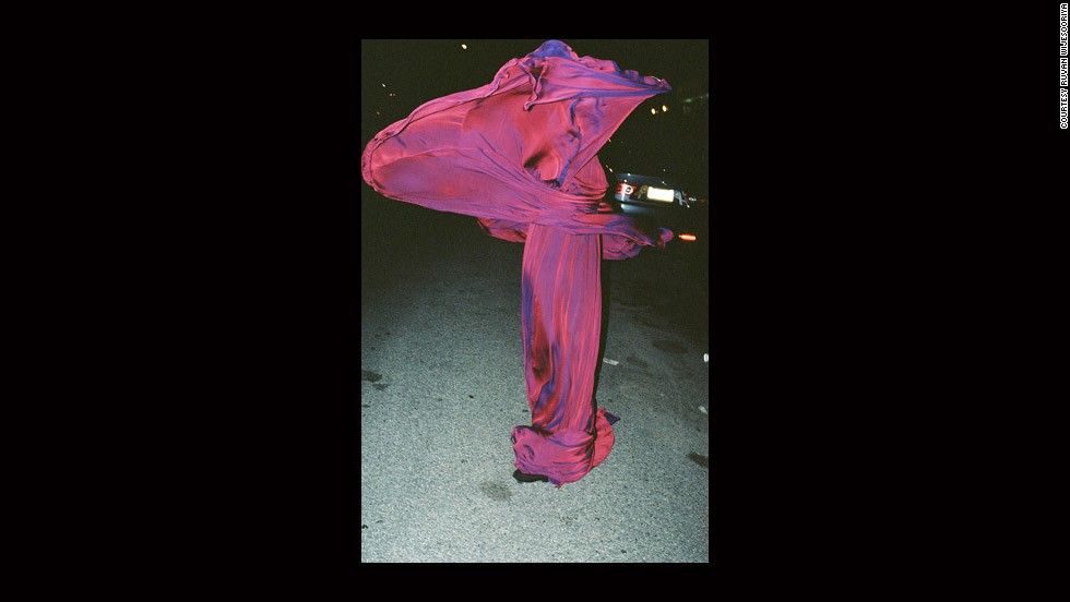 """PURPLE DRESS SCULPTURAL,"" RUVAN WIJESOORIYA (2010)<br /><strong><br />CNN: Are there any global centers for new photography?</strong><strong><br />MK</strong>: I wanted to book to be as global as possible and there are 35 photographers coming from 14 countries, so there is a good global spread. I would also say that it became very apparent that (while there is spread) the centers still hold. New York and London and to a lesser degree Paris ... no matter where (the photographers) came from, it's where they gravitated to. How you become a photographer has loosened up but when you start working at a certain level, working for the international fashion magazines, the centers are New York City and London."