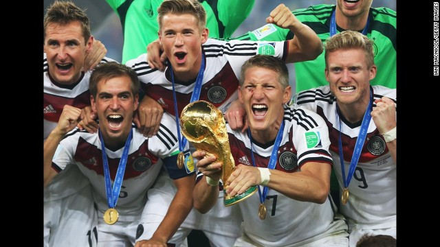 Bastian Schweinsteiger of Germany lifts the trophy during the 2014 World Cup final match between Germany and Argentina at The Maracana Stadium on July 13, 2014 in Rio de Janeiro, Brazil.