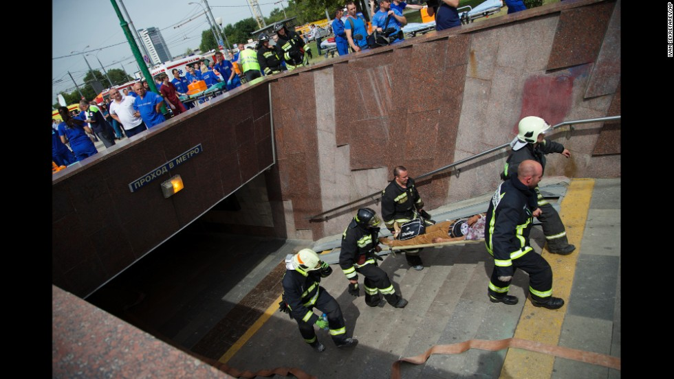 Paramedics and firefighters carry an injured man after a metro train derailed in Moscow on Tuesday, July 15. It was not immediately clear what caused the derailment, which took place during morning rush hour in the Russian capital.