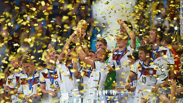 Germany celebrates with the World Cup trophy after defeating Argentina 1-0 in extra time during the 2014 FIFA World Cup Brazil Final match between Germany and Argentina at Maracana on July 13, 2014, in Rio de Janeiro, Brazil.
