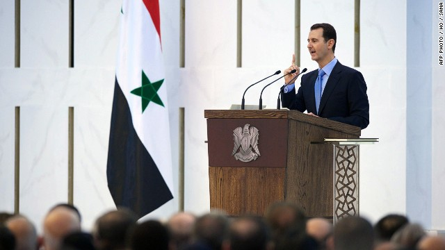 "A handout picture released by the official Syrian Arab News Agency (SANA) on July 16, 2014, shows Syrian President Bashar al-Assad being sworn in for a new seven-year term, during a ceremony at the Presidential Palace in Damascus. Assad, 48, won a June election denounced as a ""farce"" by his detractors as it was staged more than three years into a devastating war that has killed more than 170,000 people and uprooted millions."