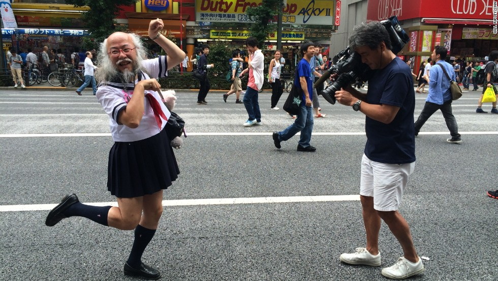 CNN photojournalist Hidetaka Sato records Kobayashi walking from Akihabara station to Waseda Juku -- a Tokyo cram school -- where he lectures students on the importance of being an individual.