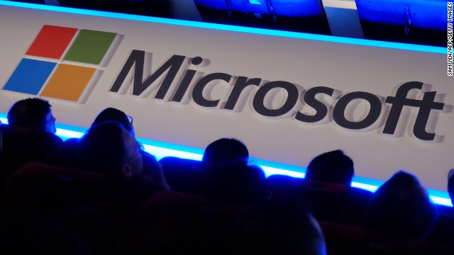 International buyers listen to a speeck in front of a Microsoft logo during the Computex tech show in Taipei on June 4, 2014.  More than 1,500 exhibitors, including some of the world's leading technology brands, will set out their stalls at Computex in the capital, with 130,000 visitors expected for the five-day event.  AFP PHOTO / SAM YEH        (Photo credit should read SAM YEH/AFP/Getty Images)