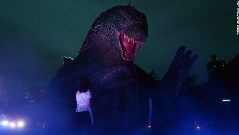 "A <a href=""http://www.cnn.com/2014/05/15/showbiz/gallery/tsuburaya-godzilla/index.html"" target=""_blank"">Godzilla</a> statue is illuminated at a park in Tokyo on Thursday, July 17, to promote the recent reboot of the movie franchise."
