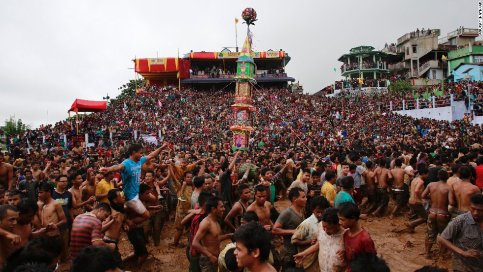 "Jaintia tribesmen carry a ""Rath,"" or chariot, during the Behdienkhlam festival in Jowai, India, on Wednesday, July 16. The annual celebration aims to bring a good harvest season and drive away plague and diseases."