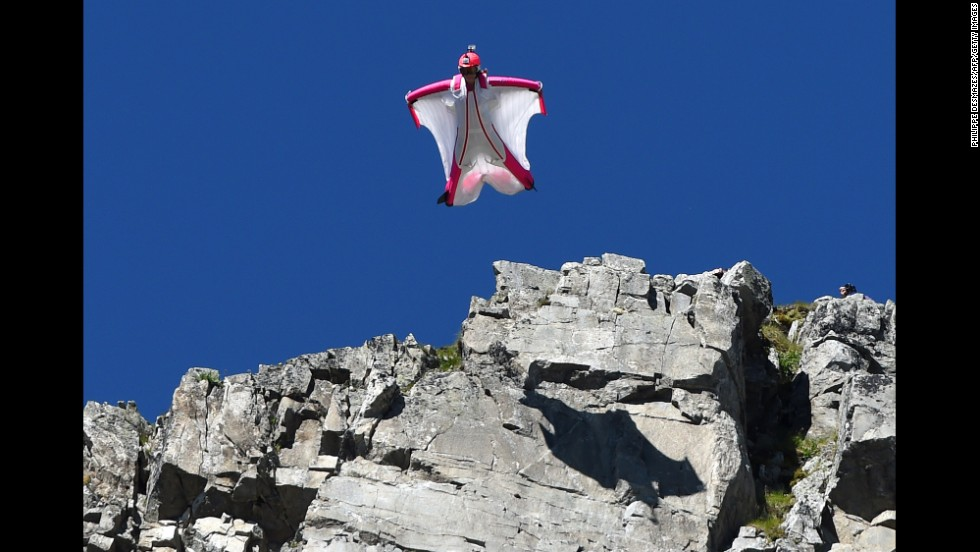 Switzerland's Geraldine Fasnacht jumps off Brevent Mountain in a wingsuit to fly over the French ski resort of Chamonix on Wednesday, July 16.