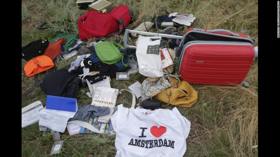 Books, bags, a tourist T-shirt. Ukraine's government said it had received reports of looting, and it urged relatives to cancel the victims' credit cards. But a CNN crew at the scene July 19 said it did not see any signs of looting.