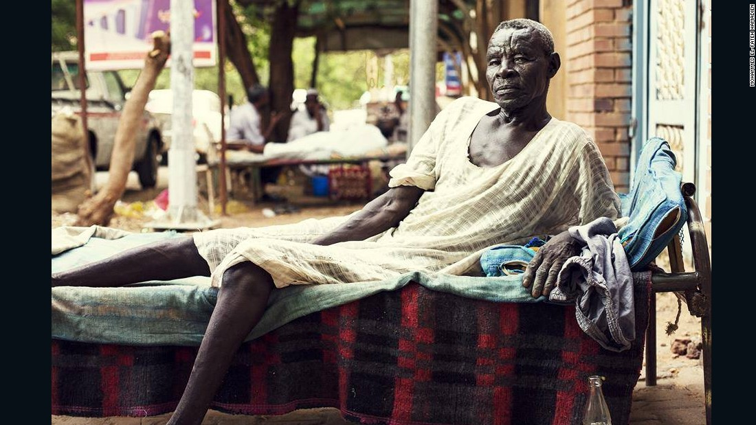 "Amm Saeed from Nuba Mountains - works as a watchman and helps out all the neighbourhood despite his not-so-young age.<br />How old are you 'Amm Saeed?<em><br />""Ninety-something. I'm from Nuba Mountains. I have children and 4 wives. I have 10 children from my older wife, 4 are dead, and the rest....The boys are now grandfathers and the girls grandmothers!"" </em>"