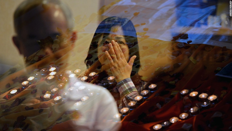 "People pray for the victims of <a href=""http://www.cnn.com/specials/world/mh17-specials-page/index.html"" target=""_blank"">Malaysia Airlines Flight 17</a> at a church outside Kuala Lumpur on July 18."