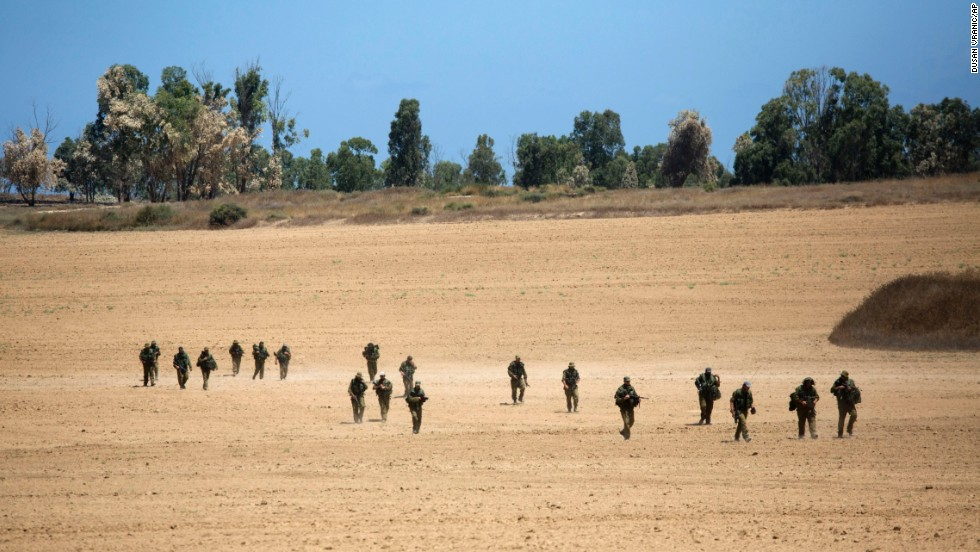 Israeli soldiers patrol near the Israel-Gaza border on July 18.