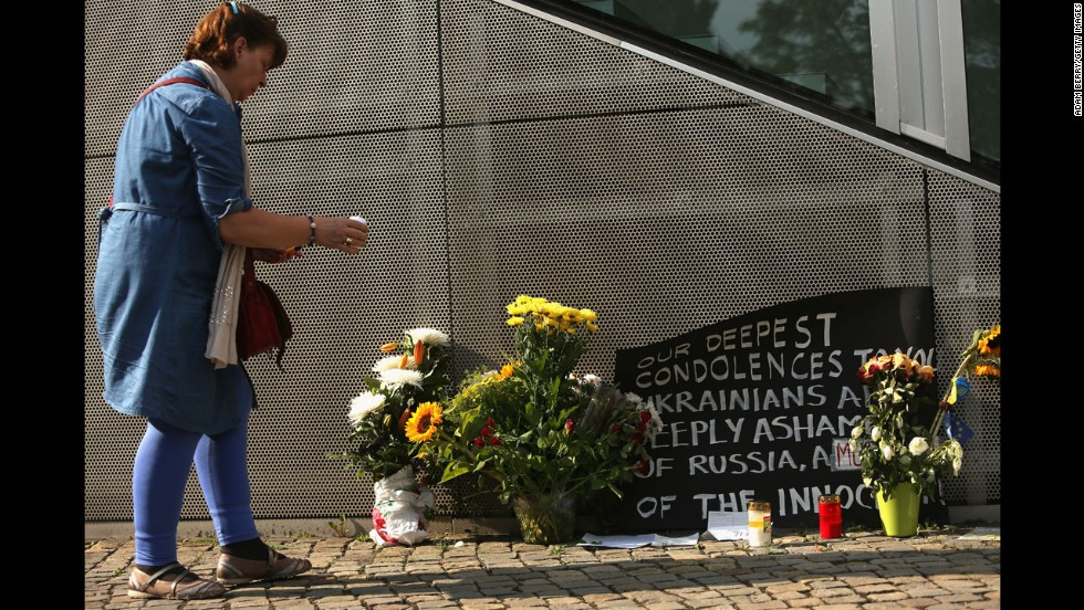 A woman in Berlin places a candle at a memorial on July 18.