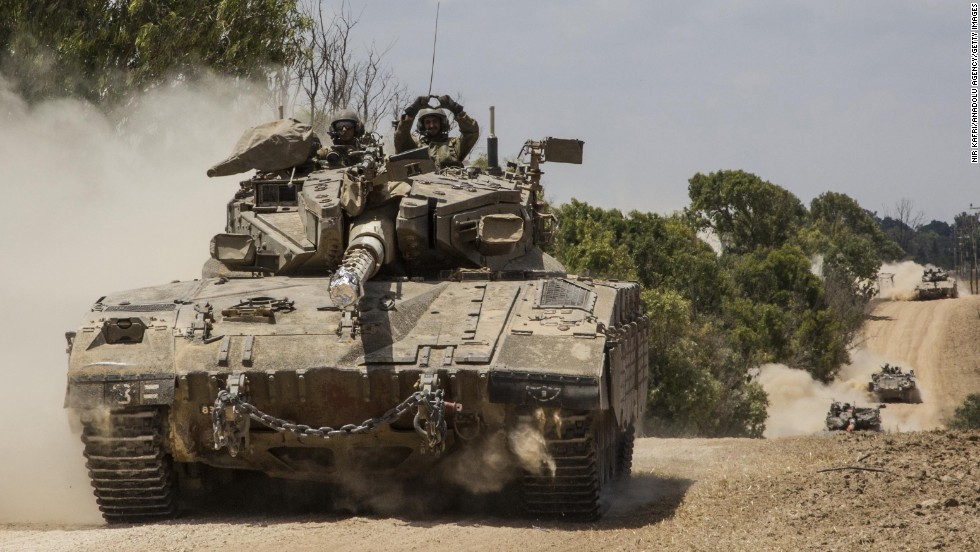 Israeli ground forces move to the Gaza border on July 18.