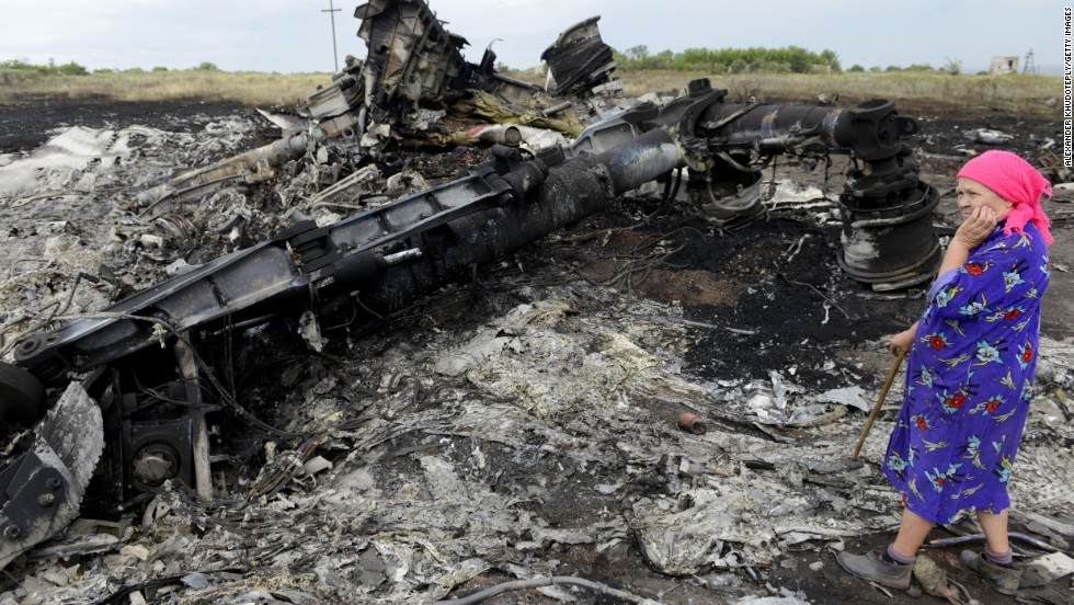 A woman looks at wreckage on July 19, 2014.