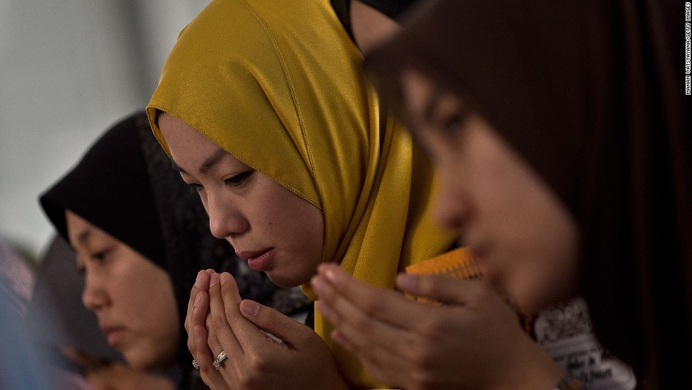 Friends of Nur Shazana Mohamed, a crew member aboard the flight, take part in a special remembrance prayer at a mosque in Putrajaya, Malaysia, on July 19.