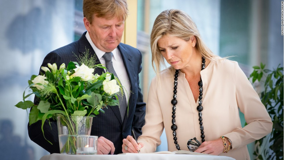 King Willem-Alexander and Queen Maxima of the Netherlands sign a condolence register for relatives and friends of the victims of Malaysia Airlines Flight 17 at the Ministry of Safety and Justice in The Hague on Friday, July 18.
