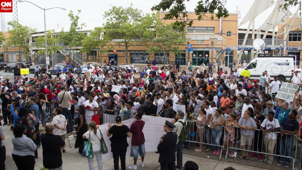 Garner's family, friends and people from the Staten Island community gathered in July 2014 to demand a full investigation into the incident.