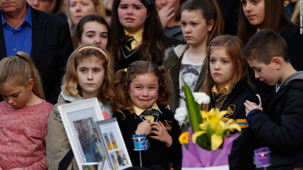 Mourners in Eynesbury, Australia, attend a memorial service Sunday, July 20, for a family of five killed in the disaster.