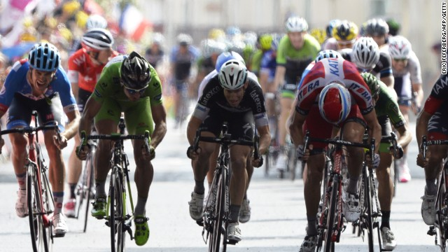 Alexander Kristoff of the Katusha team wins the 15th stage of the Tour de France with Jack Bauer (far left) overhauled in the final meters.