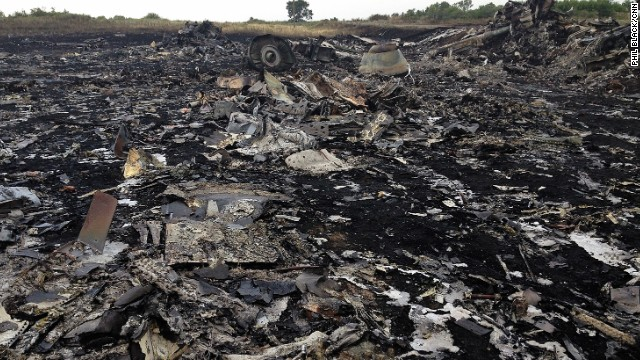 "HRABOVE, UKRAINE:  ""When the sun came up we saw this...and much worse."" - CNN's Phil Black, July 19.  Photo shows the crash site of Malaysian Airlines Flight MH17, which was shot down over Ukraine.  Folllow Phil (@philblackcnn) and other CNNers along on Instagram at instagram.com/cnn."