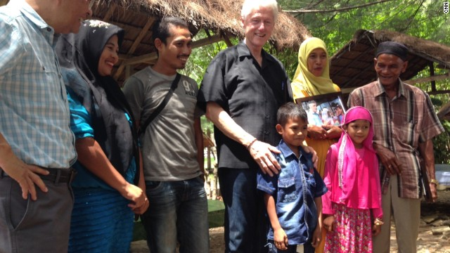 Clinton visits a mosque in Banda Aceh, Indonesia during his Southeast Asia tour.