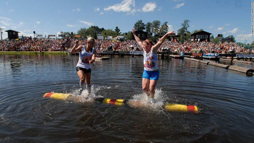 Verstegen, left, competes in the logrolling event at the Lumberjack World Championship in 2011. Using foot maneuvers and endurance, the athletes try to dislodge their opponent into the water.