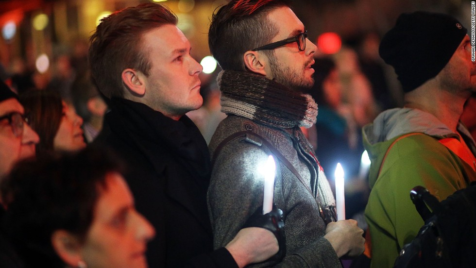 People in Melbourne gather to mourn the victims during a candlelight vigil at Federation Square on July 22.