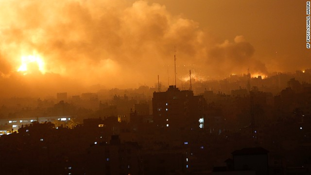 Smoke rises as flames spread across buildings after Israeli strikes in the Shijaiyah neighborhood in Gaza City, Tuesday, July 22, 2014.