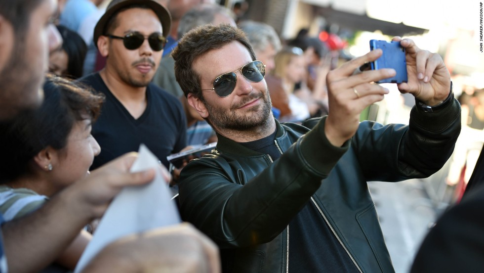 "Actor Bradley Cooper snaps a selfie with fans Monday, July 21, at the premiere of ""Guardians of the Galaxy"" in Hollywood."