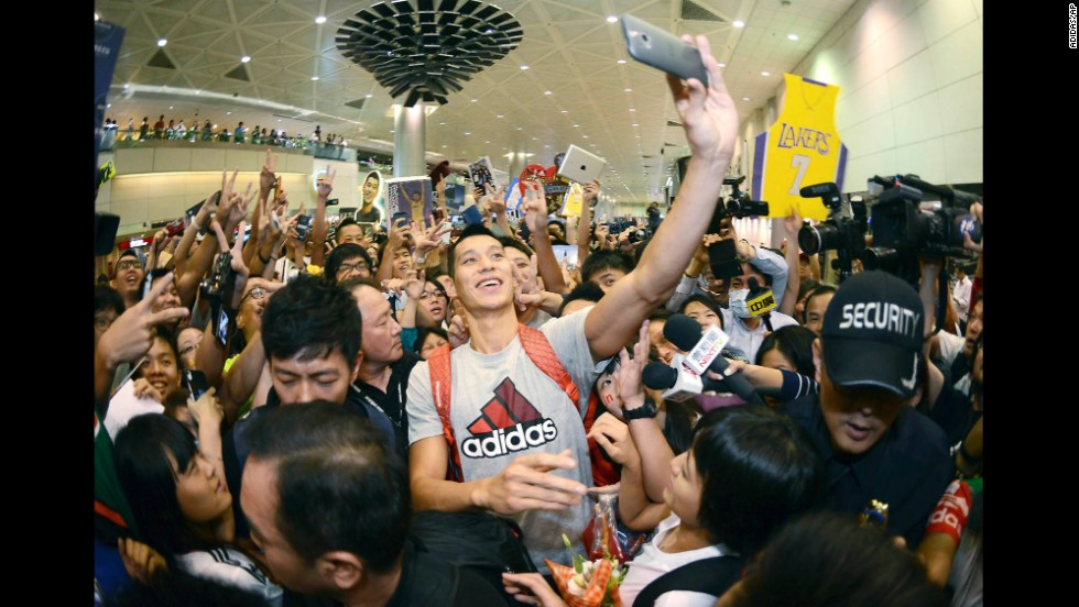 Pro basketball player Jeremy Lin takes a selfie with fans as he arrives at the Taiwan Taoyuan International Airport on Thursday, July 17. Lin, who was recently traded to the Los Angeles Lakers, traveled to Taiwan to host basketball clinics and attend charity events.