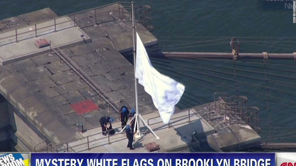 Who switched two flags atop the Brooklyn Bridge? NYPD on the case