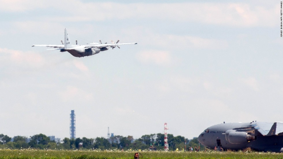A transport airplane with the Royal Netherlands Air Force, carrying the bodies of some Flight 17 victims, takes off from Kharkiv on July 23.